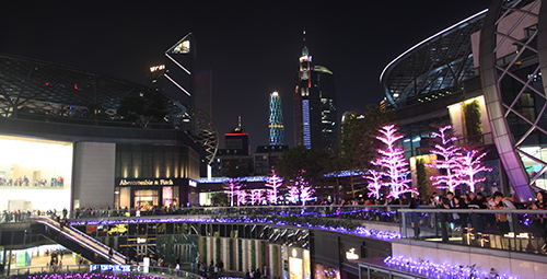 Busy shopping mall at night